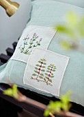 Cushion with floral embroidered panels