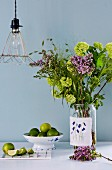 Bouquet in mason jar decorated with embroidered fabric