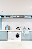 Washroom with light blue shelves and cupboard fronts