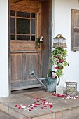 Welcoming bouquet of long-stemmed roses and lady's mantle next to front door