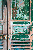 Vintage wooden door with peeling paint