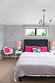 Bedroom in gray and white with color accents in pink