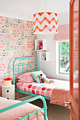 Glance into the nostalgic children's room with two metal beds