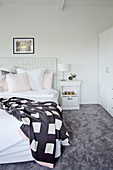 Bright bedroom with gray carpeting
