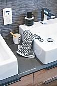 A square washbasin set into a quartz washstand