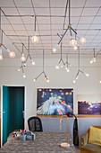 Designer lamps above desk in study