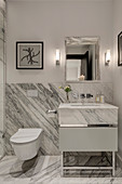 Clear lines and large marble panels in modern bathroom