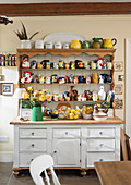 Collection of ceramic animals on rustic dresser