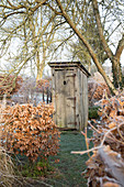Outhouse in wintry garden