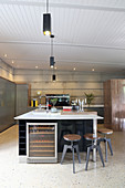 Elegant kitchen island, wine cabinet and industrial-style barstools