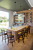 Home bar with rustic brick wall and counter