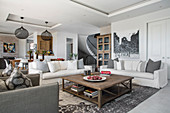 Sofas, armchair and coffee table in open-plan interior