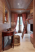 Opulent bedroom with bunk beds and wood panelling