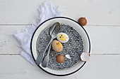 Cutlery, painted Easter eggs and egg shells on vintage plate