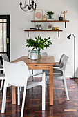 Wooden dining table and designer chairs