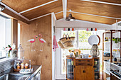Renovated kitchen with wooden cladding on the ceiling and on the wall