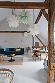 Bright, converted attic in rustic loft-apartment style with blue-and-white colour scheme