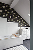 Dark floral wallpaper in classic attic bathroom