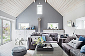 Blue and grey living room with open roof structure