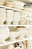 White crockery on open-fronted shelves