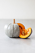 Wedge cut from pumpkin painted grey with white stripes