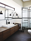 Walk-in shower with glass door in masculine, Industrial-style bathroom