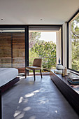 Modern bedroom with panoramic windows and balcony