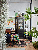 View into vintage-style bedroom through houseplant leaves