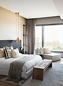 Elegant bedroom in shades of grey and cream