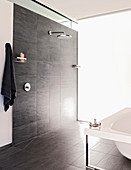Floor-level shower with grey tiles in modern bathroom