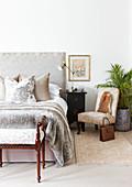 Elegant bedroom in pale grey and beige