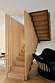 Foot of elegant staircase with wooden balusters in living area