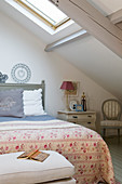 French-style attic bedroom under sloping ceiling