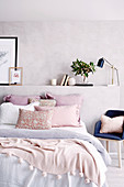 Double bed with pastel pink accessories