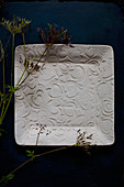 Wildflowers on square plate with embossed love-heart pattern