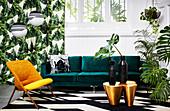 Green velvet sofa and houseplants in exotic living room