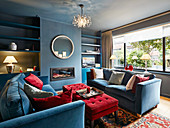 British-style living room in blue and red with fitted shelves