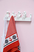 Coat pegs made from white-painted toys