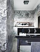 Black and white cloud-patterned wallpaper in elegant bathroom