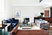 Glamorous, double-height living room in mid-century modern style
