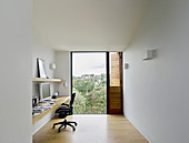 Purist study with panoramic view through floor-to-ceiling window