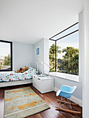 Modern bay window in child's bedroom with panoramic view