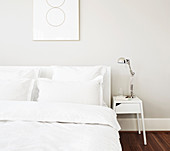 Anglepoise lamp on bedside table in white bedroom