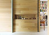 Decorative accessories in a rectangular niche in a wooden wall