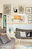 Scandinavian style sofas in front of a picture wall with a horizontal window