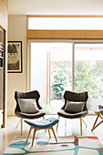 Two gray armchairs and blue Scandinavian style ottoman