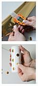 Blumenvase selber machen: Punkte aus Metallic Klebfolie ausstanzen und auf die Dose kleben