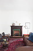 Vintage leather sofa, fireplace and chairs in lounge
