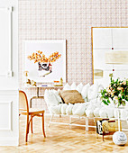 White cushion sofa on parquet floor against wallpapered wall