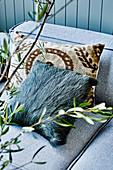 Pillows on gray sofa